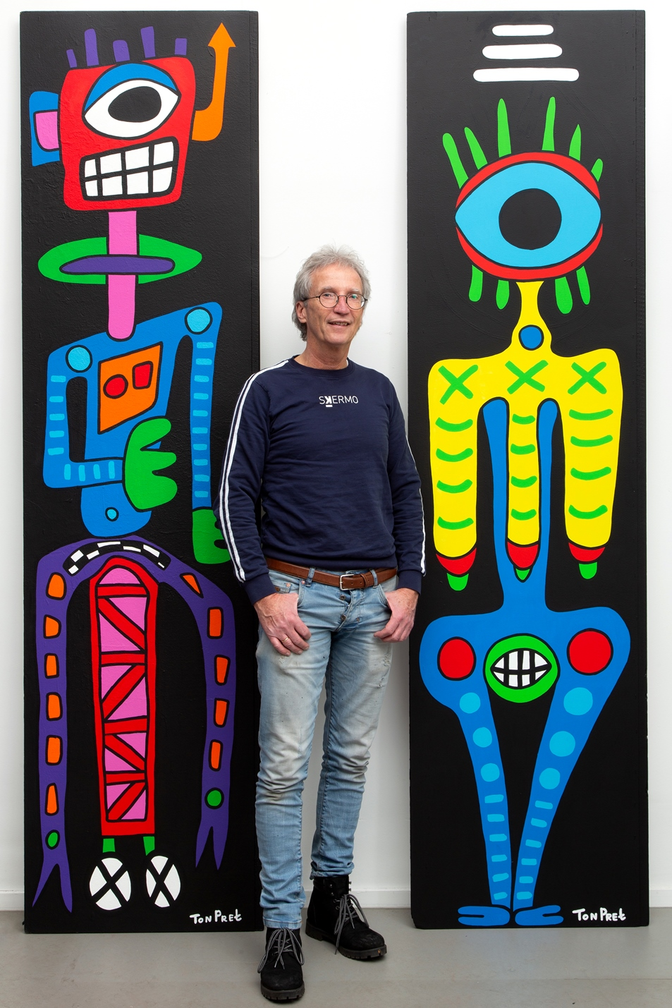 The artist between two panels ca 63cm x 245cm acrylic on wooden panels